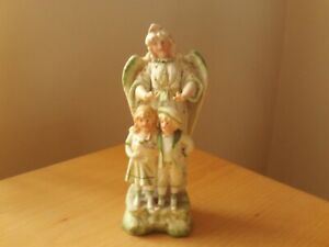 "Vintage Porcelain Guardian Angel Watching Figurine 7 3/4"" High."