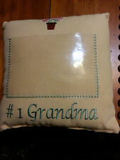 A YELLOW PILLOW WITH THE #1 GRANDMA WITH A PLACE FOR A PICTURE