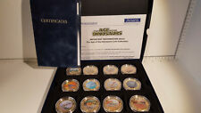 More details for (lot 601) the age of the dinosaurs full coin collection. gold plated. 2318/ 4950
