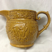 GREEN T.G. ENGLAND JUG PITCHER EMBOSSED HUNTING SCENE DOGS HORSES HONEY AMBER