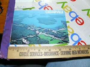 CEDARVILLE MICHIGAN LES CHENEAUX ISLANDS CITY BUILDINGS MOTELS PIER aerial view