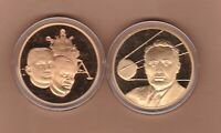 TWO HISTORY OF MAN IN FLIGHT BRONZE MEDALS WITH CAPSULES NEAR MINT CONDITION