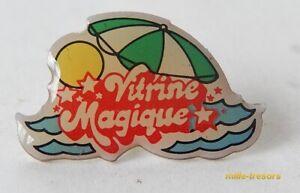 Ancien PIN'S : VITRINE MAGIQUE