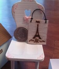 Miniature wooden Eiffel Tower hanging sign