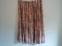Women's polyester skirt size 14 or size 16 peach and brown pattern knee length