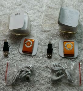 Mp3 multimedia player mini orange. Comes w wired earbuds. 2 set bundle.