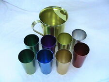 VINTAGE COLOR CRAFT ALUMINUM PITCHER WITH 8 ASSORTED COLOR DRINKING GLASSES