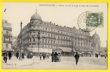 """cpa 34 - MONTPELLIER Place de la Comédie """"Grande Maison"""" Caviste G. DELAHOUTRE"""
