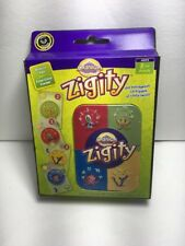 Cranium Zigity New Sealed Nib Deluxe Tin Clear Cards Game