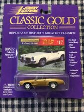 1974 OLDS CUTLASS W-30,, CLASSIC GOLD, Johnny Lightning 1:64, NEW on Card!