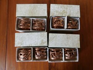 vintage 8 napkin rings copper with African animals pattern boxed date 1959