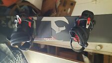 snowboard with Burton bindings. Barely used. No defects..have boots and bag
