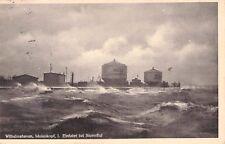 Seltene Foto AK 1942: WILHELMSHAVEN Molenkopf 1. Einfahrt bei Sturmflut@gelaufen