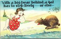 HUMOR -With big bear behind gal steps lively - A/S Walter Wellman Comic Linen PC