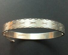 Beautiful Sterling Silver Diamond Cut Bangle With Zig Zag Clasp and Safety Chain