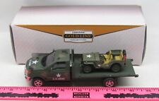 The Menards ~ U.S. Army mack truck with flatbed with military jeep