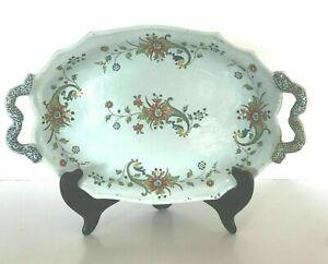 Plat a anses en faïence à bord chantourné  décor floral .XVIII siècle.