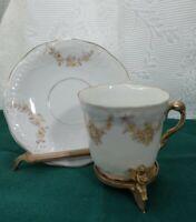 Vintage Porcelain Tea Cup & Saucer Yellow floral design & gold handle & Trim.