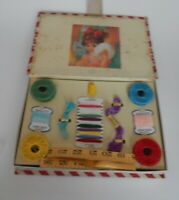 Vintage child's sewing box with thread and sewing aids by Madamoiselle No. 860
