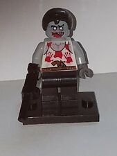 LEGO ZOMBIE WITH BLOODY HAND ON TORSO AND GUN