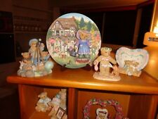 50 rare cherished teddies  in all plus wooden stand