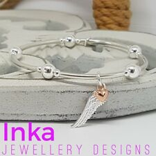 Inka 925 Sterling Silver bead & noodle Stacking Bracelet with Angel wing charms