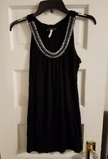 Woman's Black small dress with beaded neck