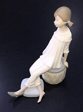 Lladro 1084 Girl with Mother's Shoe Sitting on Ottoman Matte Porcelain Figurine