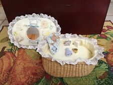 BABY BOY MINIATURE DOLL WITH LAYETTE  IN STRAW BASKET