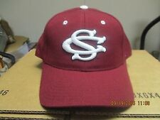"SOUTH CAROLINA GAMECOCKS-DK RED CAP WITH ""SC"" IN WHITE OUTLINED IN BLACK ON FRT"