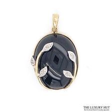 9CT YELLOW GOLD BLACK ONYX & DIAMOND PENDANT