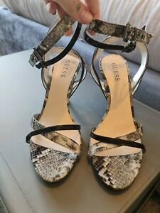 Guess black heels, snake skin strappy high heels. Women's shoes size 7