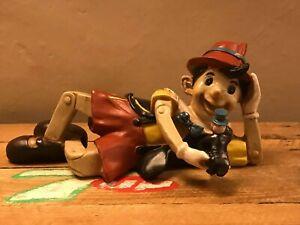 Rare Small Lying Pinocchio and Jiminy Cricket resin statue