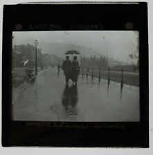 More details for 1900s magic lantern a wet day couple with umbrella scarborough