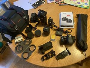 Canon EOS Rebel t5i dslr camera with several lenses and accessories