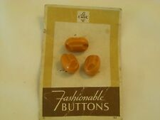 Vintage Three Bakelite Butterscotch Buttons on original card Carved & oblong Ai