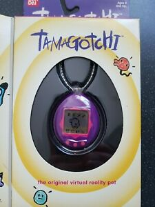 Original Bandai 1996-1997 Tamagotchi gen 1 - purple - boxed - english version