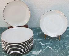 Porcelaine française Onze assiettes à dessert @