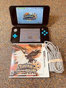 Nintendo 2DS XL Handheld System - Black & Turquoise with Pokémon Ultra Sun
