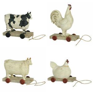 Clayre & Eef Kuh Hahn Huhn Henne auf Rädern Rollen Tiere Shabby Vintage Landhaus