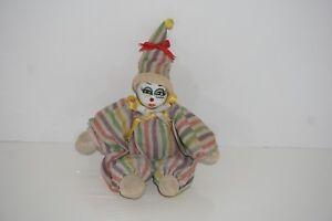 Vintage Creepy Sand Bag Clown.painted Glass Face.
