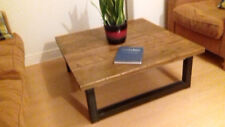 Coffee table in reclaimed timber and steel framed legs,medium oak finish