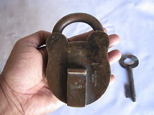 An old solid brass heavy padlock lock decorative shape with key