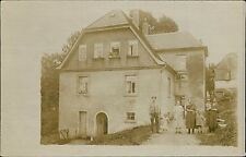Family outside house people in windows cat sitting doorway  JE.1698