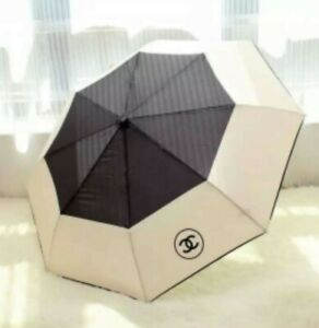 CHANEL CC TWO TONE BLACK & IVORY FOLDING UMBRELLA. SHIPPING WORLDWIDE