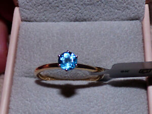 Blue Topaz Solitaire Gold Ring