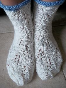 Hand knitted lace pattern socks, antique white with sparkly blue trim