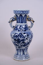 Chinese blue and white porcelain vase with twin dragon mask handles. Quality.