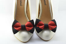A pair of black base linen with red shoe clips