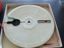 A scotch reel to reel tape in a Tudor tape box, used but in good order